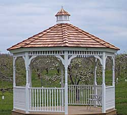 This beautiful classic gazebo at the edge of the orchard is a perfect location for the bride and groom to share their wedding vows.